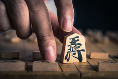 Japanese chess and hands Royalty Free Stock Image