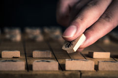 Japanese chess and hands Stock Images