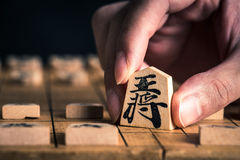 Japanese chess and hands Royalty Free Stock Photos