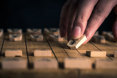 Japanese chess and hands Royalty Free Stock Photo
