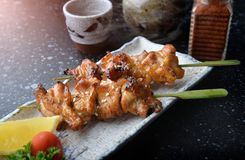 Japanese chicken grill or yakitori. Japanese chicken grill or yakitori serve in restourant set on Japanese style dish with flash lighting royalty free stock photos