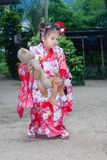 Japanese Child Kimono and bear Stock Images