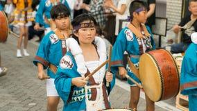 Japanese children dancing traditional Awaodori dance in the famous Koenji Awa Odori festival, Tokyo, Japan royalty free stock photography