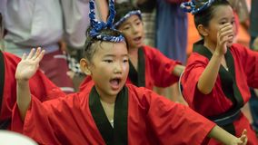 Japanese children dancing traditional Awaodori dance in the famous Koenji Awa Odori festival, Tokyo, Japan stock image
