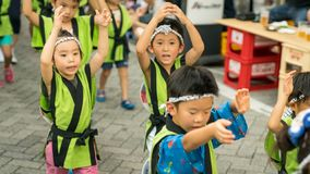 Japanese children dancing traditional Awaodori dance in the famous Koenji Awa Odori festival, Tokyo, Japan royalty free stock photos