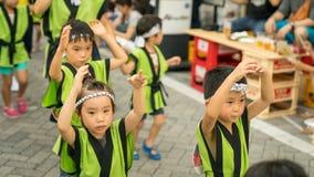 Japanese children dancing traditional Awaodori dance in the famous Koenji Awa Odori festival, Tokyo, Japan. Tokyo, Japan - August 2018: Japanese children dancing stock photo
