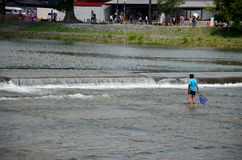 Japanese children fishing fish at Hozugawa River of Arashiyama Royalty Free Stock Images