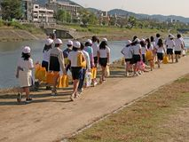 Japanese children group. Group of Japanese children walking on the riverside-Kamogawa river-Kyoto stock images