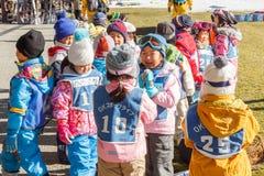 Japanese Children prepare before skiing at Fujiten ski resort Stock Images