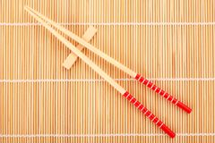 Japanese chop sticks on bamboo Stock Image