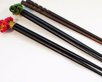 Japanese Chopsticks. This is a shot of three wooden Japanese chopsticks. They are stained a dark color Stock Photography