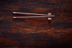 Japanese chopsticks on brown wooden table. Top Stock Photo
