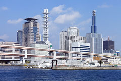 Japanese city Kobe skyline with flyover bridge, office buildings Royalty Free Stock Image
