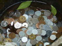 Japanese coins in water Royalty Free Stock Images