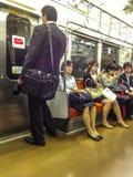 Japanese commuters on train Stock Photo