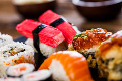 Japanese concept with sushi on the wooden table Stock Images