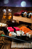 Japanese concept with sushi on the wooden table. Fresh and tasty Japanese sushi set Royalty Free Stock Photo
