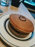 Japanese confection,Dorayaki.Red-bean pancake which consists of two small pancake-like patties made from castella wrapped around a royalty free stock image