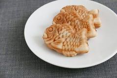 Japanese confectionery taiyaki fish cake wagashi on plate Stock Photos