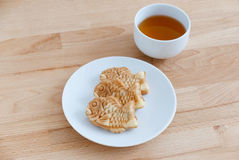 Japanese confectionery taiyaki fish cake wagashi on plate with t Stock Photos