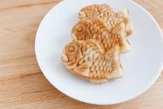 Japanese confectionery taiyaki fish cake wagashi on plate on tab Stock Photos