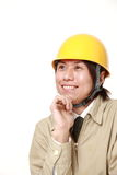 Japanese construction worker dreaming at his future Royalty Free Stock Images