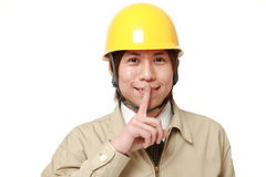 Japanese construction worker whith silence gestures Stock Photo