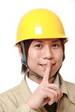 Japanese construction worker whith silence gestures Royalty Free Stock Image