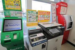 Japanese convenience store ATM and photocopier service. Japanese convenience store services provided such as ATM, money transfer and photocopying services stock photos