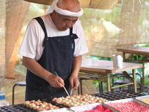 Japanese Cook preparing Japanese food Takoyaki Stock Photos