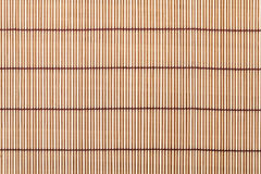 Japanese cooking mat over bamboo table Stock Image