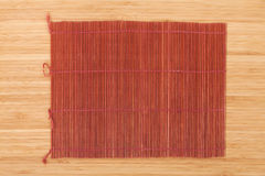 Japanese cooking mat over bamboo table Royalty Free Stock Images