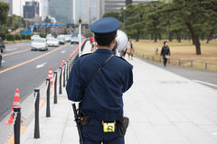 Japanese cop announcing Royalty Free Stock Images