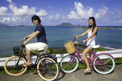 Japanese couple on bikes Royalty Free Stock Photo