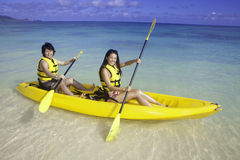 Japanese couple in kayak Royalty Free Stock Photography
