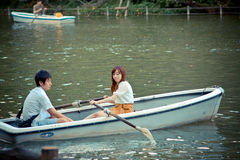 Japanese couple  are paddling a boat  in a park Stock Photo