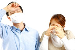 Japanese Couple suffers from allergic rhinitis� Stock Photo