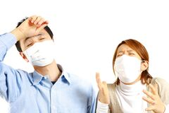 Japanese Couple suffers from allergic rhinitis  Royalty Free Stock Images