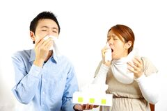 Japanese Couple suffers from allergic rhinitis  Royalty Free Stock Photography