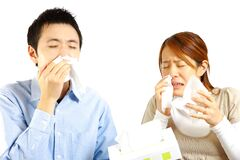 Japanese Couple suffers from allergic rhinitis  Stock Images
