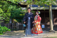 Japanese couple in traditional wedding dresses. A Japanese couple dressed in traditional wedding kimono. The woman wears a colorful bridal kimono called royalty free stock photos