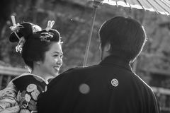 Japanese couple wearing traditional japanese kimonos walk on the street of Gion, Kyoto Stock Images