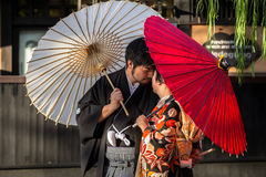 Japanese couple wearing traditional japanese kimonos walk on the street of Gion, Kyoto Royalty Free Stock Photos