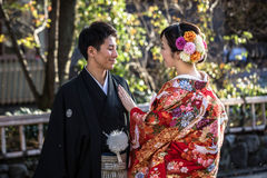 Japanese couple wearing traditional japanese kimonos walk on the street of Gion, Kyoto Royalty Free Stock Photo