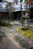 Japanese Courtyard. A serene Japanese courtyard with a stone lantern Stock Images
