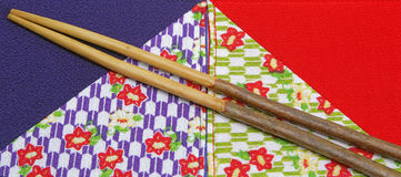 Japanese craft. Image of two chopsticks made by cherry tree blossom twigs on two pieces of specific Japanese fabric Royalty Free Stock Image
