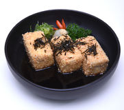 Japanese Crispy deep fried Tofu or Agedashi Tofu served in tentsuyu broth isolated on white background with clipping path Stock Photography