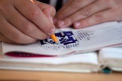 Japanese crossword puzzle filled. With blue ballpoint pen stock photography