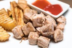 Japanese Cube Steak. On White dish Closeup shot stock photos