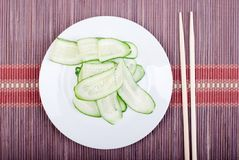 Japanese cucumber salad with thinly sliced cucumbers in white pl Royalty Free Stock Images